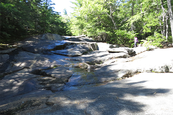 the sunny slabs of the lower falls of Beede Falls, New Hampshire