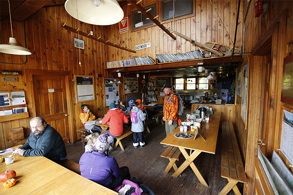 inside the AMC Zealand Falls Hut