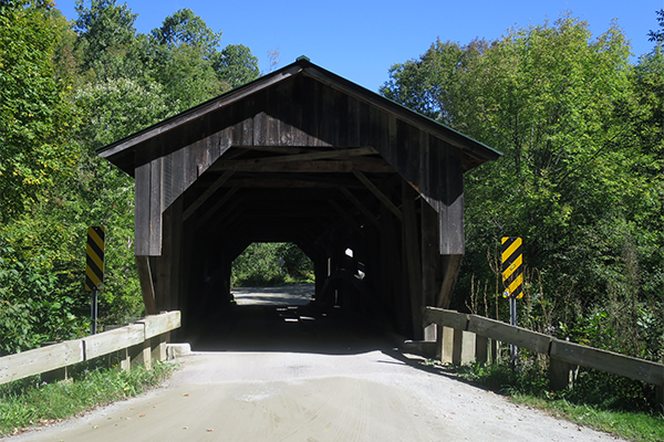 the covered bridge at the parking trailhead of Brewster River Gorge, Vermont